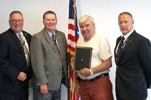 Commissioners Joseph Adams and Wendell Kay w/Bob Wiegand of The Hideout POA and Commissioner Brian S