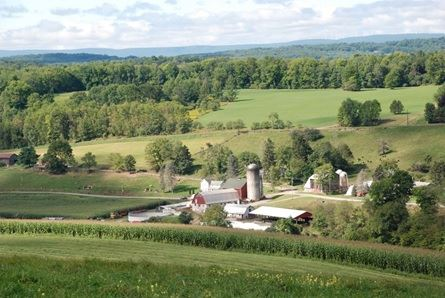 A panoramic view of a Wayne County farm and surrounding hillsides.